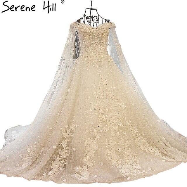 New Style Luxury Bride Train Wedding Dress White Beading Crystal Tulle Sexy  Sleeveless Wedding Gown 2018 Vestido De Noiva b718d44a7ce0