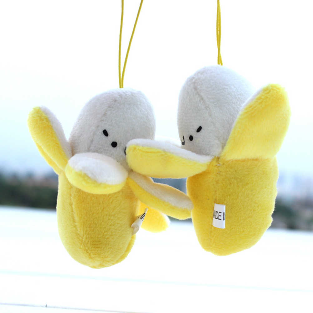 1 Uds. De moda encantos Pom muñeca llavero Regalo boda niñas fiesta baratija lindo Emoji juguete de peluche de plátano llavero teléfono mujer bolsa
