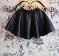 Frete grátis roupa infantil feminina NOVO 2015 outono inverno moda faux couro preto pu Uma Linha de saias crianças tutu meninas