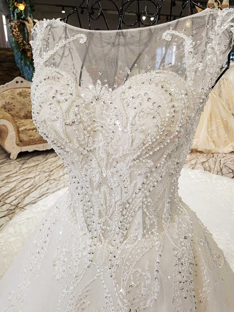 ... LS8833 luxury wedding dresses o-neck sleeveless lace up backless ball  gown beading wedding dresses ... cb2a7a77535f