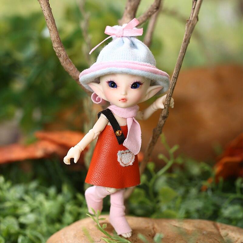 Oyuncaklar ve Hobi Ürünleri'ten Bebekler'de Ücretsiz kargo Fairyland FL Realpuki Roro BJD Bebek 1/13 Pembe Gülümseme Elfler Oyuncaklar Kız için Küçük Reçine Eklemli Bebek'da  Grup 1