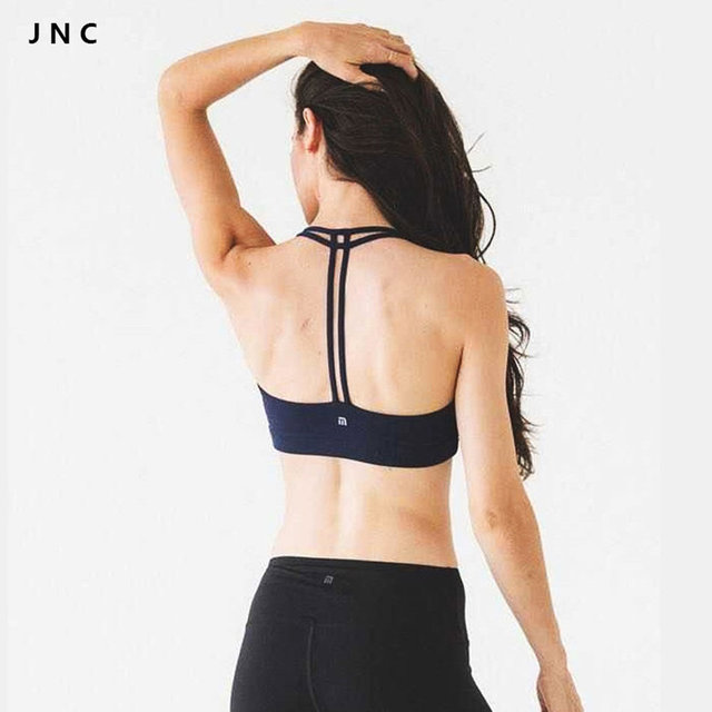 25cec41842813a Women s New Yoga Tops fitness apparel Cute Women cross back bras in black  Quick Drying sexy girl running Bra Tank Top Vest gear