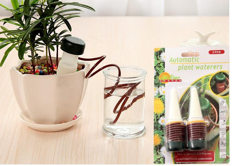 Envío gratis, 2 piezas / lote, dispositivo de riego automático, en - Productos de jardín