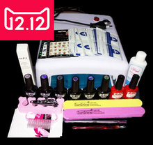 EM–128 Free shipping uv gel nail polish set ,nail tools professional set ,uv gel color with uv led lamp  set ,nail art tools