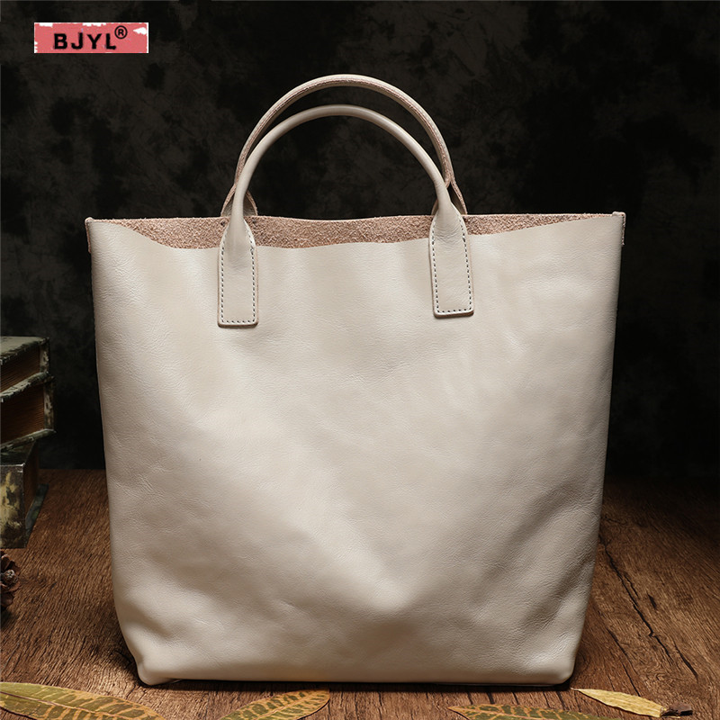 купить BJYL Genuine Leather Women handbag female new top layer cowhide shoulder bag wild big simple tide Korean version of the tote bag по цене 6410.12 рублей