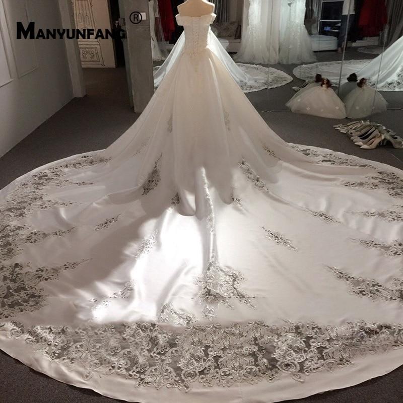 Royal Cut-out Train Satin Bridal Dresses 2020 Beads Sequins Cap Sleeves Wedding Dress 2020 New Arrival A Line Wedding Dress