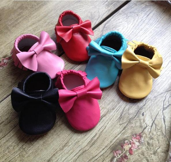 Hot 2016 Negro Rosa Mocasines Zapatos de Bebé de Cuero de Gamuza Genuina primeros Caminante de Suela Suave Franja Arco Zapatos Para Niñas niños recién nacido