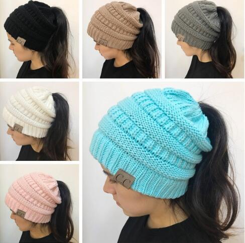 d1e194155d6 2018 Fashion Women s Girl Stretch Knit Hat Messy Bun Ponytail Beanies Holey Warm  Winter Hats New Trendy CC Warm Winter Hat