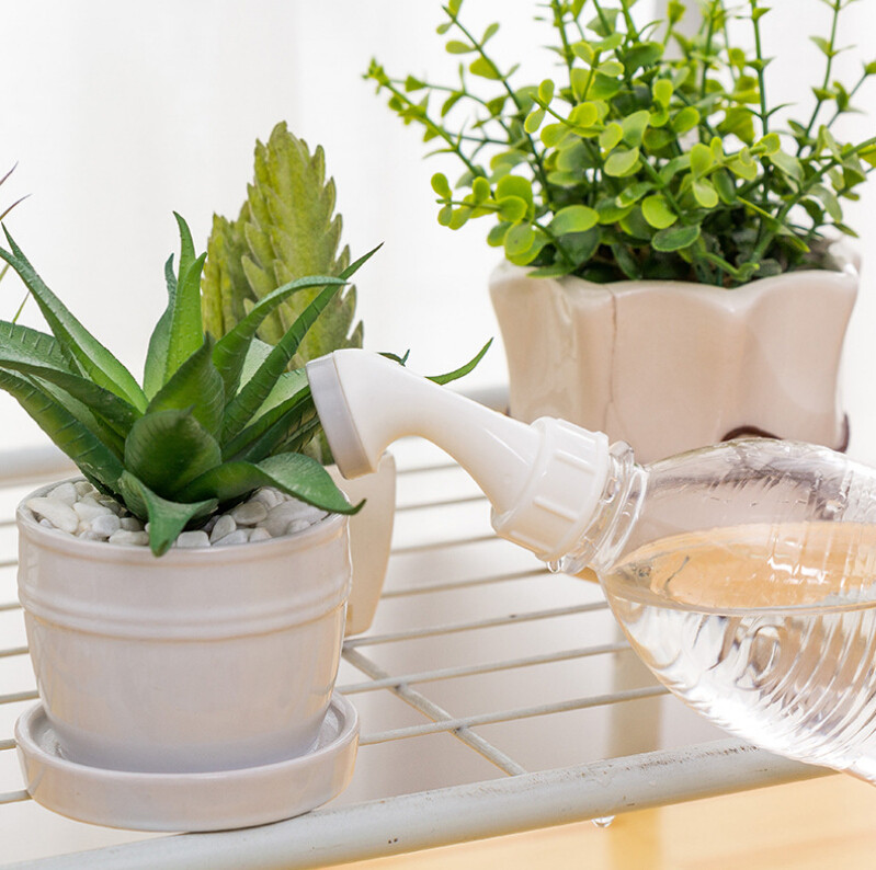 Image 1 - 2PCs Bottle Top Creative Watering Garden Plant Flower Sprinkler Water Device Household Potted 2019 hot sale   G520-in Water Cans from Home & Garden