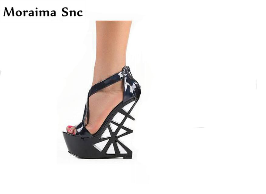 купить Moraima Snc Newest sexy women Rome type sandals peep toe platform strange style fretwork high heel platform party shoes по цене 5643.79 рублей