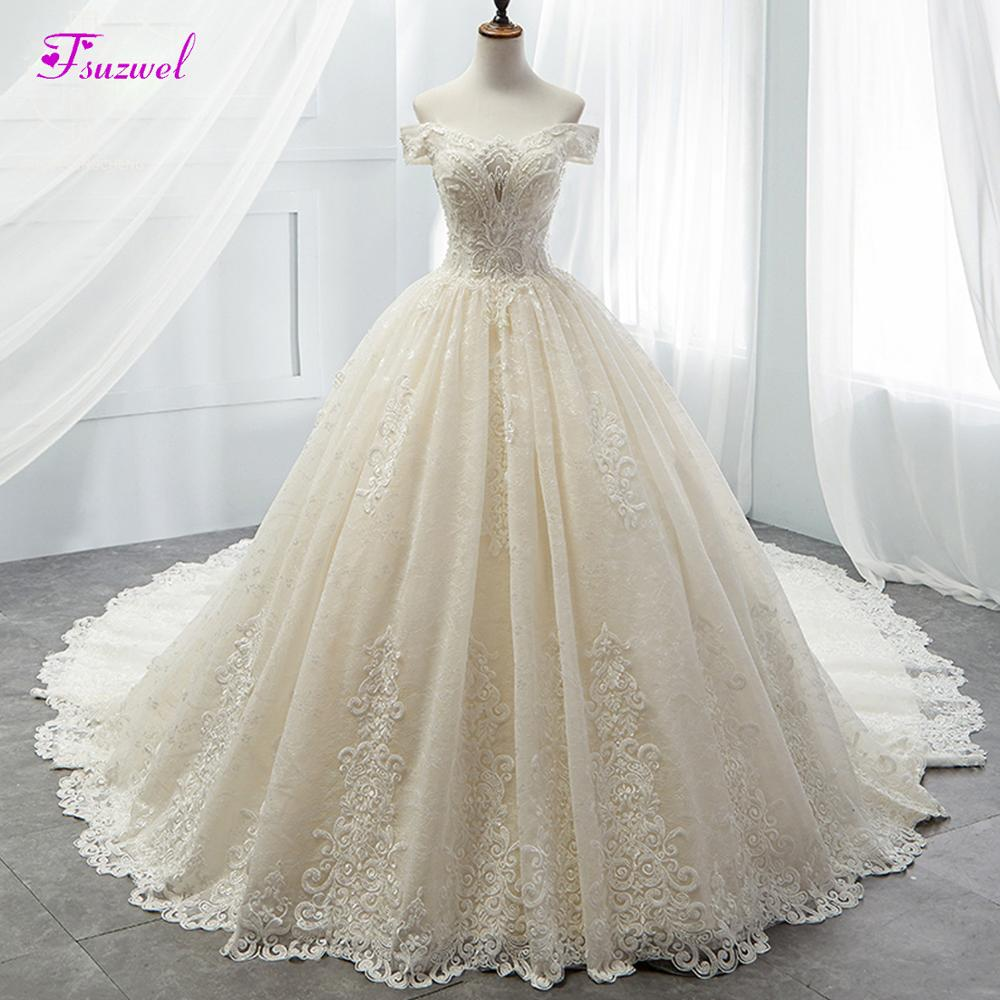 New Gorgrous Appliques Chapel Train Lace A Line Wedding Dress 2019 Luxury Beaded Boat Neck Princess
