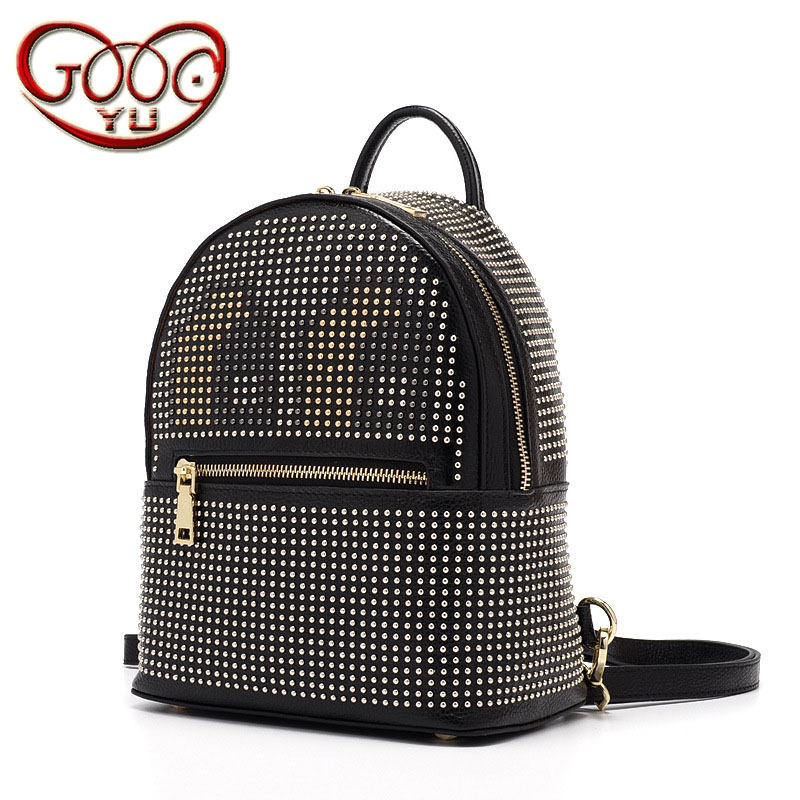 Korean version of the new women's leather backpack first layer of leather rivets animation cartoon pattern vertical section back korean version of the first layer of leather vertical section square shoulder messenger bag in the bag fashion casual tassel lea