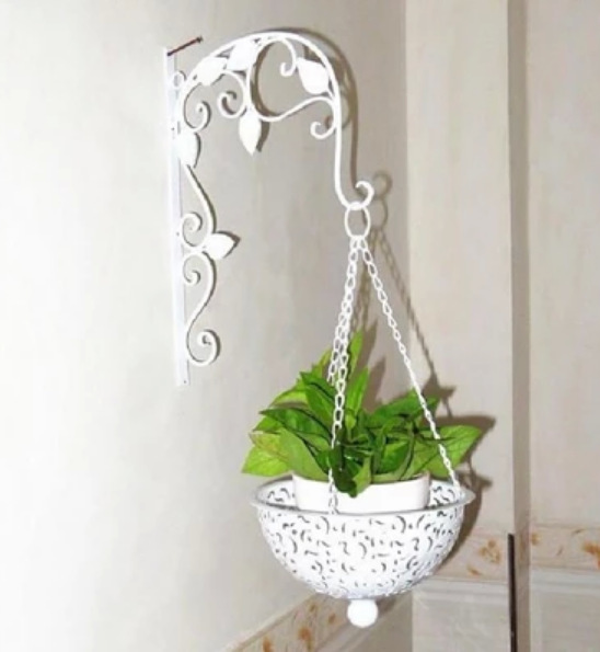 C Iron Wall Hanging flower baskets decorate the walls of the basket ...