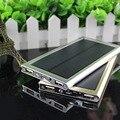 Ultra-delgada caja de metal banco de la energía solar 12000 mah dual usb cargador solar de baterías de li-polímero powerbank para iphone 6 s