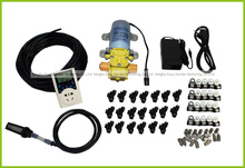Pump outdoor cooling system with cycle timer.  misting system. .Great for poultry shed, greenhouse, patio