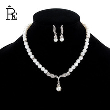 цена на RE Imitation Pearl And Silver Color Rhinestone Wings Of Angle Chokers On The Neck For Girls Necklace Earrings Jewelry Sets Gift