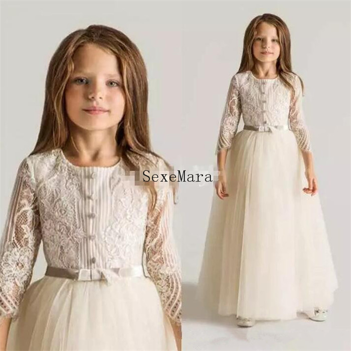 Latest Ivory White Lace Tulle Flower Girls Dresses For Wedding Long Sleeves Appliques Ruched New First Communion GownsLatest Ivory White Lace Tulle Flower Girls Dresses For Wedding Long Sleeves Appliques Ruched New First Communion Gowns