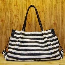 Kostenloser versand Mode reisetasche schwarz und weiß echtleder frauen tasche erste schicht rindleder big bags größe 50*31*15 cm