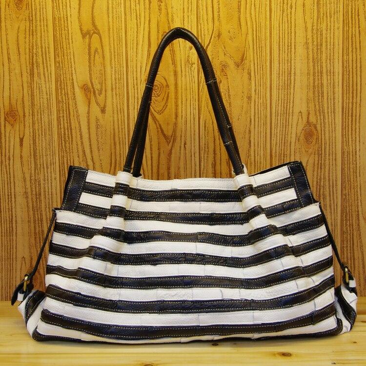 Livraison gratuite mode sac voyage noir et blanc en cuir véritable sac pour femme première couche de peau de vache grands sacs taille 50*31*15 cm