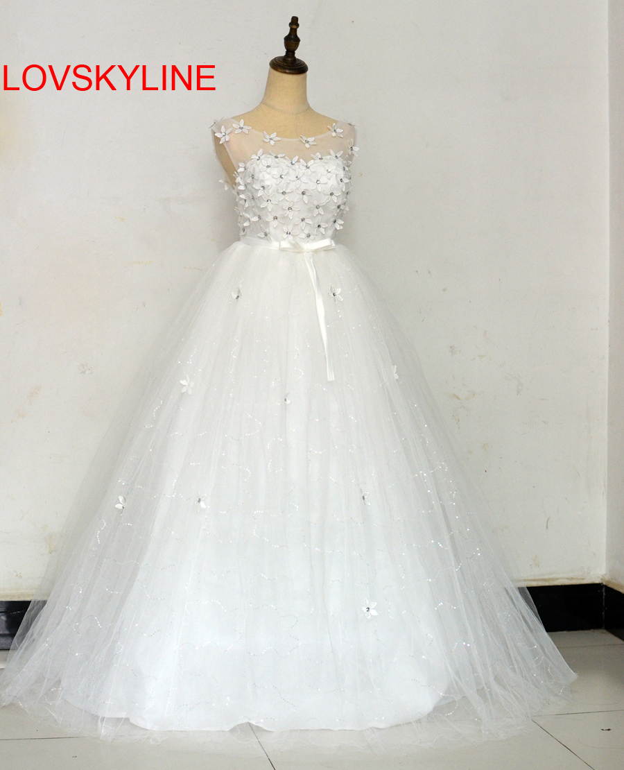 LOVSKYLINE Wedding Dress 2018 Vestido De Noiva Sheer New Arrival Sexy A-Line Flowers Robe De Mariage Backless Bride Dresses