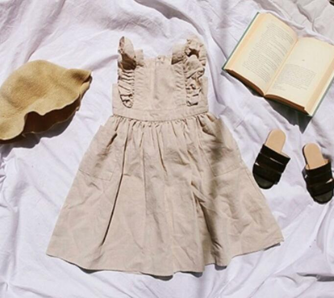 a8bb93788b31d Japanese Style Girls Simple Fly Sleeve Dress With Pocket Western Classic  Cotton Linen Summer Dresses Wholesale