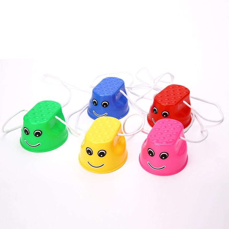 1 paire Mini échasses chaussures enfants Sports de plein air jouet amusant épaissir plastique Balance formation Smiley visage pour Interaction enfants cadeau
