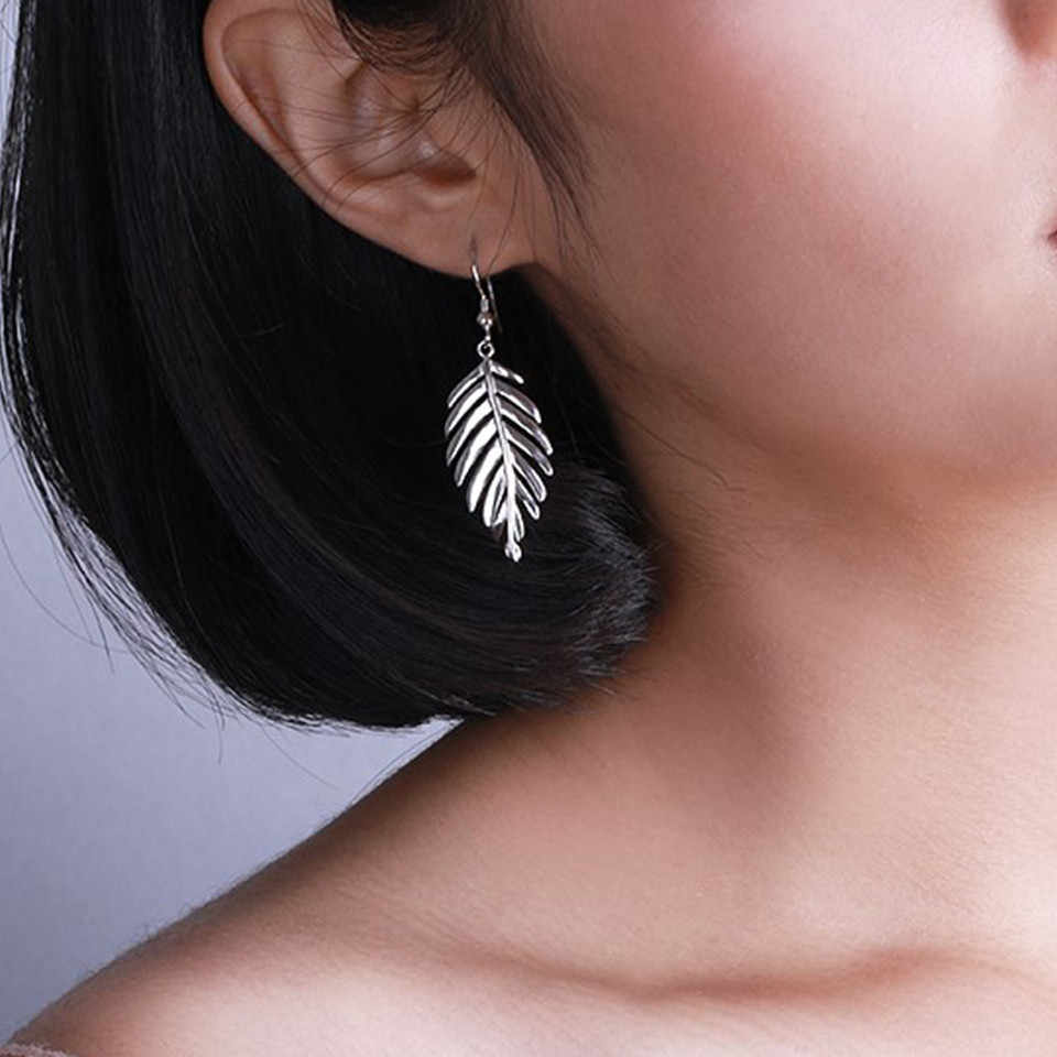 Hot fashion leaf golden,silver earrings new design hollow earring hanging earrings charm affordable jewelry wholesale women gift