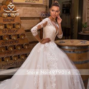 Image 5 - Sexy V hals Applicaties Wedding Dress Swanskirt Half Sleeve Lace Up A lijn Hof Trein Prinses Bruidsjurk Robe De Mariage LZ10