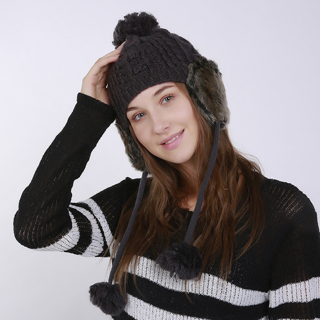 2017 Women s Winter Knitted Bomber Hats Beanie for Girls Top Hair Ball  Hanging Ball Earflap Hat Casual Fashion Female Caps 4a0c48d18ca