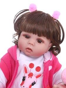 Image 5 - NPK 48 CM bebe pop reborn peuter meisje pop in roze jurk full body zachte siliconen realistische baby Bad speelgoed waterdicht