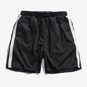 Корейские модные шорты для мужчин, повседневные полосатые шорты для бега, уличная эластичная резинка на талии, розовые, черные спортивные шорты, летние штаны