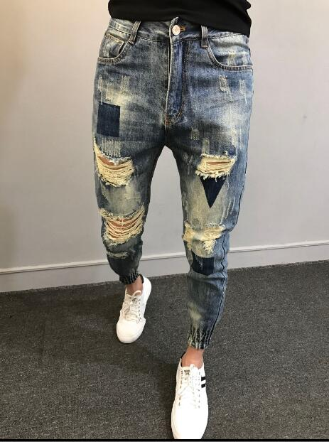 2018 Fashionable mens jeans with holes in their feet M-5XL! Big yards mens trousers