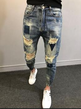 2018  Fashionable men's jeans with holes in their feet  M-5XL!  Big yards men's trousers