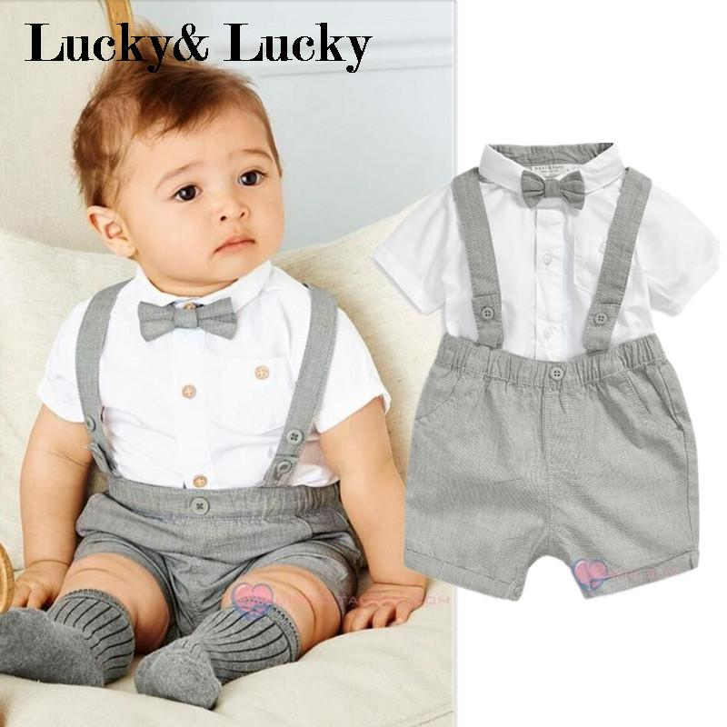 Baby infant boy's 5 pieces outfit suit dress Includes: % cotton shirt, button front blue vest, beige pant with brown belt and bow tie. Made in Turkey This nice looking 5 piece boy's dress outfit is.