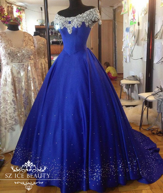 c8d81ca6073 Puffy A Line Royal Blue Off Shoulder Evening Dress With Sleeves Bling  Appliques Beaded Crystal 2017