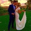 Сексуальный глубокий v-образным вырезом крышка втулки русалка кружева платье невесты аппликациями цветы свадебные платья бич 2015