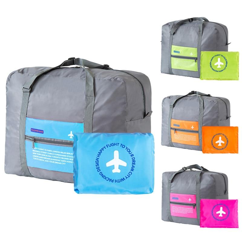 Vedenpitävä nailon-kokoontaitettava suurikapasiteettinen paketti, joka kuljettaa matkatavaroiden kuljetusta
