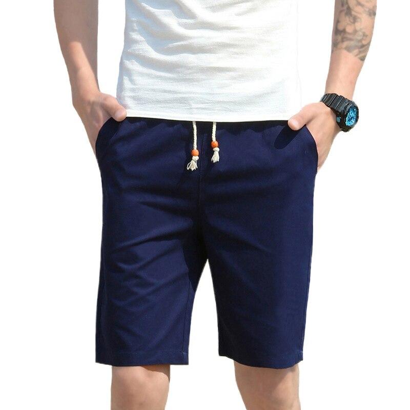 2018 ropa de marca pantalones cortos de cintura elástica para hombre Pantalones cortos casuales transpirables sólidos para hombre Pantalones cortos de algodón de playa calientes hombres