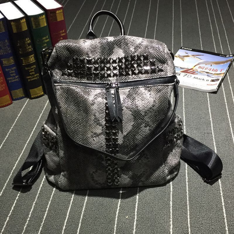 BSDT backpack Europe and the United States punk fashion snake leather   rivet shoulder package bag female FREE SHIPPING free shipping embossing letters package europe fashion genuine leather single shoulder hand his female bag