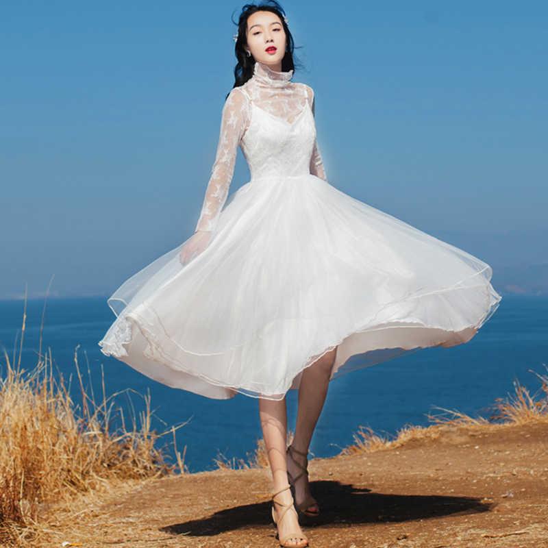 Весной и летом новый белый сетка вышитые кружевное платье студентка пляжного