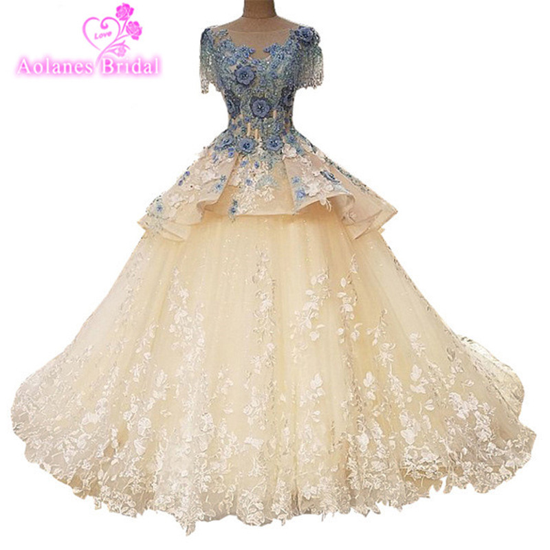 Gorgeous Sheer Ball Gown Wedding Dresses 2017 Puffy Lace Beaded Applique White Sleeveless Arab Wedding Gowns robe de mariage