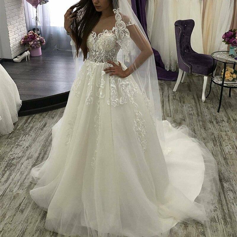 Élégante dentelle Applique sans manches col en v a-ligne robes de mariée à lacets robe de mariée princesse robes taille personnalisée