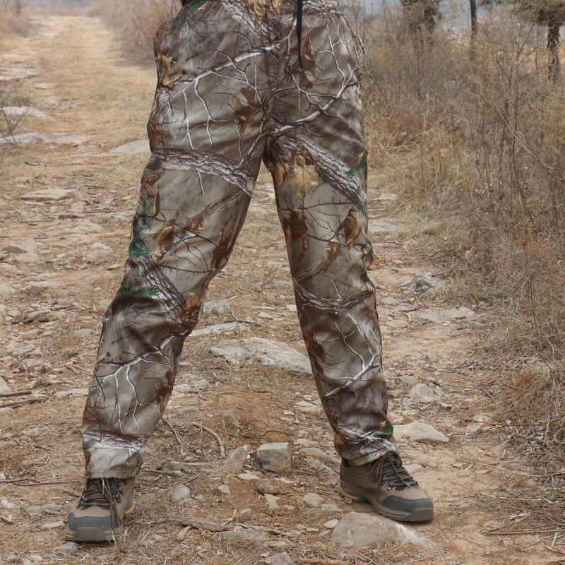แฟนกองทัพกลางแจ้งล่าสัตว์ขนาดใหญ่หลวมยาวกางเกงฤดูใบไม้ผลิ Camping การฝึกอบรม Bionic Camouflage กางเกงตกปลา