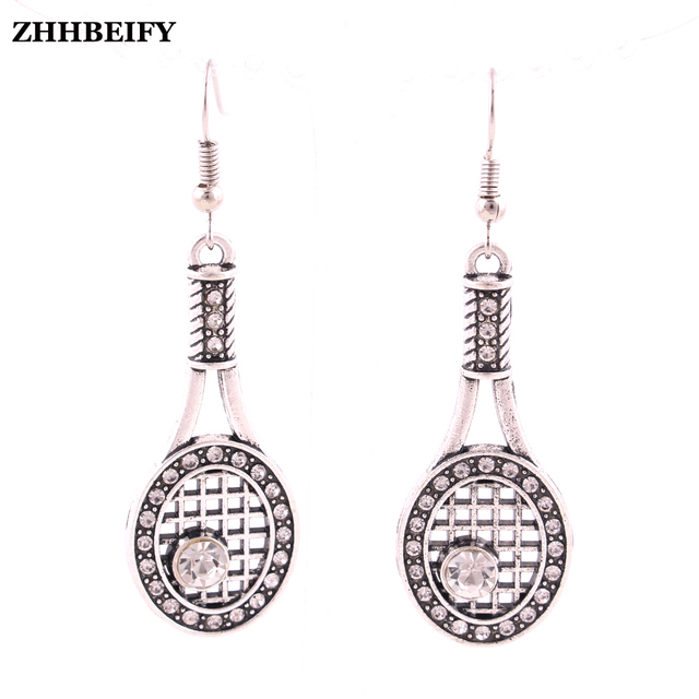 Silver Tone Earrings With Crystal Covered Tennis Racquet Charm In Surgical Steel Post Or
