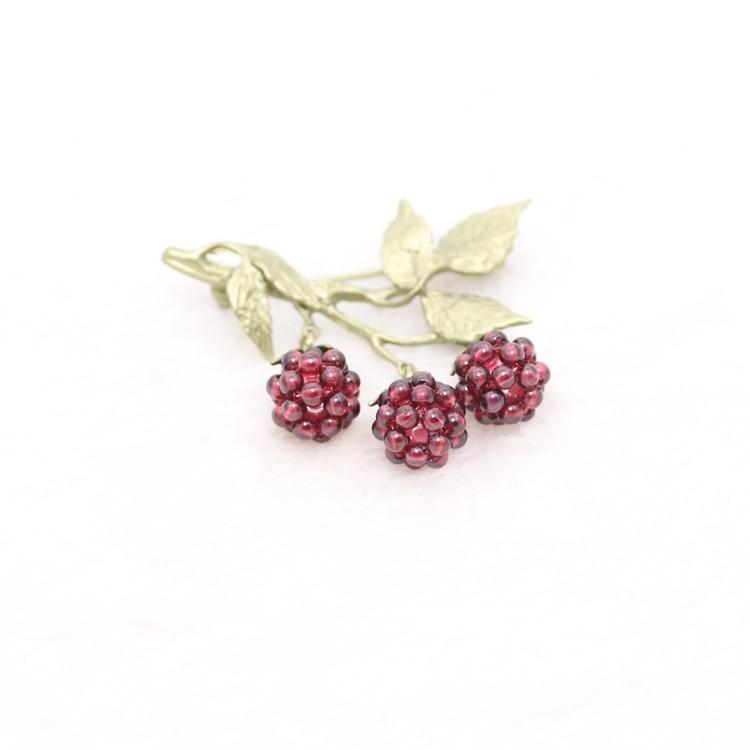 Garnet blaeberry brooch quality