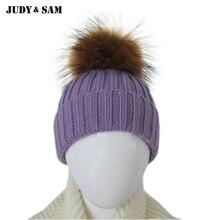 Шерстянаятеплая детская шапка с помпоном из меха енота.