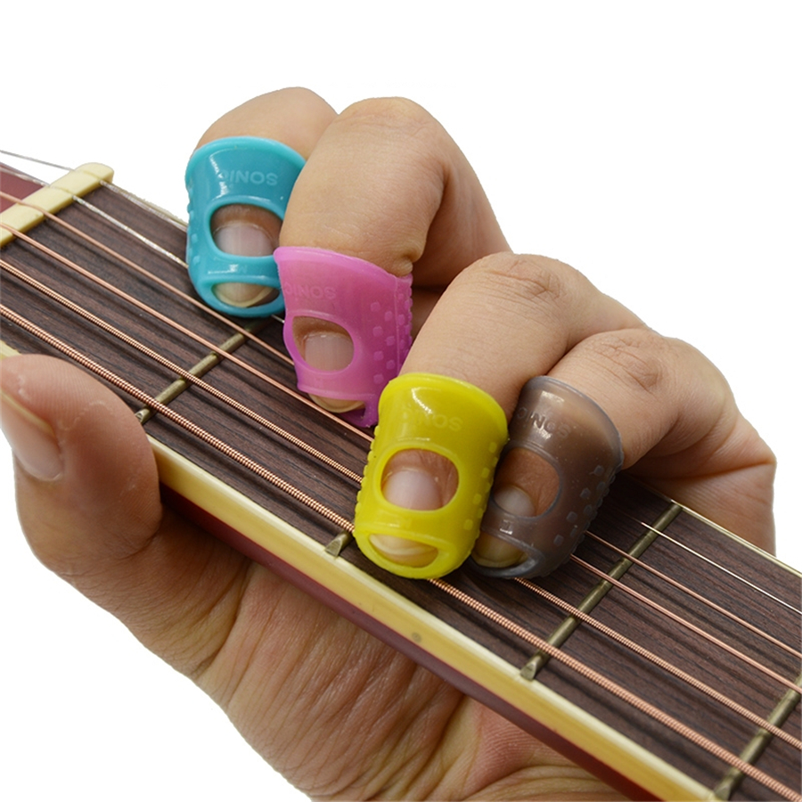 4 in 1 Fingertip Protector Fingerstall Silicone Guitar String Finger Guard Left Hand Against the Press Sore Finger Ballad Guitar tri fidget hand spinner triangle metal finger focus toy adhd autism kids adult toys finger spinner toys gags