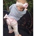 Nueva niño bebé niños / niñas PP pantalones Baby Warmer muchachas que hacen punto las polainas de la historieta diy gran arco pantalones casuales pantalones