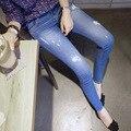 2017 Весна плюс размер джинсы женский Корейской версии новые отверстия эластичный высокой талией женщины сплошной цвет джинсовые брюки MZ350