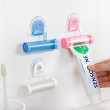 1 stücke Zufällige Farbe Rolling Rohr Zahnpasta Squeezer Saug Reiniger Einfache Dispenser Sucker Hängen Bad Zahnpasta Squeezer
